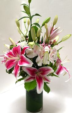 Valentine's Day flowers. Stargazer lilies, astroemeria with a touch of bouvardia.  Aspidistra-lined glass vase
