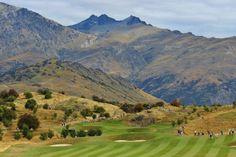 Expansive mountainous peaks surrounding The Hills Golf Course