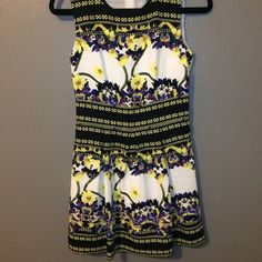 Black, purple, yellow, white, floral party dress Black, purple, yellow, white, floral party dress. Sleeveless with a slightly poofy skirt. This looks expensive!! Sadly, this cutie has never been worn. Forever 21 Dresses Mini