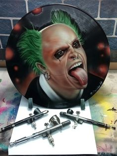 Custom painted vinyl record by Crossley custom inc