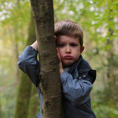 Grumpy little boy in the woods by www.sausageandsweetpea.com