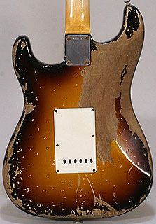 MUSIC STRINGS OF HISTORY - Back side view of an electric guitar of John Anthony Frusciante shows the wear of a well beloved instrument. RESEARCH #DianaDee - https://www.pinterest.com/DianaDeeOsborne/music-strings-of-history/ - This American guitarist, singer, producer & composer is best known as former guitarist of rock band Red Hot Chili Peppers, from 1988 until 1992, and again from 1998 to 2009. Photo pinned via Balthaser Jones.