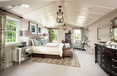 Traditional Master Bedroom with Cathedral ceiling, Exposed beam, Carpet, interior wallpaper, Pendant Light