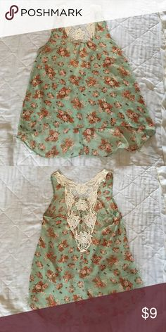High low, lace backed tank top In great condition, I've had this shirt for awhile and have just gotten tired of it Deb Tops Tank Tops