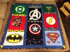 Superhero t-shirt quilt. There are some great superhero fabrics out there to use as accents on a tshirt quilt.--HawkFan #superhero #t-shirt