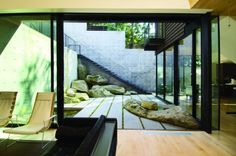 Love the elements of the courtyard. Nice boulders and window walls. Courtyard House on a Steep Site - modern - Patio - Seattle - HUTCHISON & MAUL Modern Courtyard, Courtyard Design, Internal Courtyard, Courtyard House, Patio Design, Interior Exterior, Interior Architecture, Interior Design, Outdoor Rooms