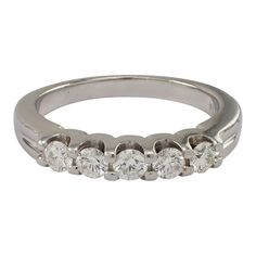 The common prong style band is set with 5 round diamonds, that weigh approximately carat total. The band is a size and weighs dwts. Estate Engagement Ring, Wedding Bands, Wedding Ring, Vintage Jewelry, Unique Jewelry, Diamond Bands, Round Diamonds, Birthstones, Handmade Gifts