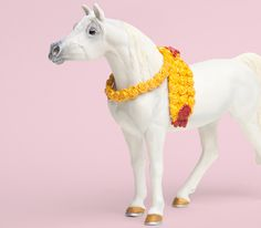 With her wreath of yellow roses, the Arabian Mare from Safari's Winner's Circle Horses collection is stately and proud, holding her head high for the judges.