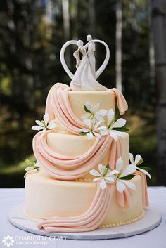 Orange Wedding Cake - Absolutely LOVE the details on the fabric style folds. Gorgeous touch.