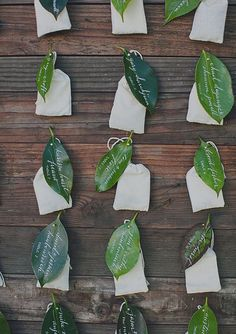 Wax leaf escort card, fixed to a wood display