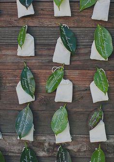 Wax leaf escort card, fixed to a wood display