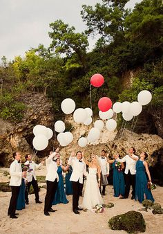 What couple wouldn't want a fun photo like this of their wedding party?
