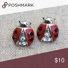 Silver Tone Red & Black Crystal Ladybug Earrings Silver tone stud earrings feature a lucky ladybug design set with red enamel, black and clear crystals.  Posts with friction backs complete the look.  Earrings measure 3/8 inch L X 3/8 inch W. Jewelry Earrings