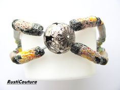 HandCarved Avant garde Metallicized Bead Cuff by rusticouture