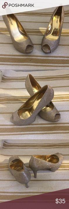 Nine West sparkling gold peep toe heels Super cute peep toe gold sparkle heels. Worn twice. In excellent condition! Nine West Shoes Heels