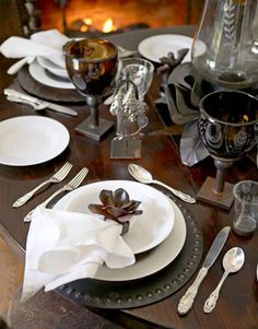 table setting by Jan Barboglio - I like the charger plates, napkin rings, lamp, and style/polish of silverware