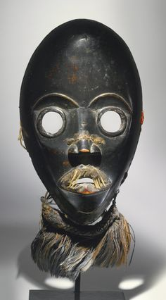DAN MASK, LIBERIA with small fragments of rachis (shaft) of domestic Chicken feathers (Gallus gallus) affixed to the lips. Height without at...