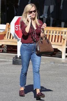 Reese Witherspoon wearing Draper James Lady Satchel in Tobacco, Bandolier Shelli Black Silver 6 Plus Case and J.Crew Silk Shirt