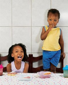 kids breakfasts/ Sao Paulo, Brazil: 4 year old Aricia Domenica Fereira & 2 yr.old Hakim Jorge Ferreira Gomes