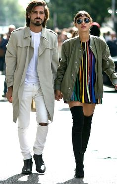 Street Style: The Best Fall Outfits from Milan Fashion Week 2015 - Stylish Milan Couple    Army green bomber jacket, a colorful striped mini dress, and sexy black suede over-the-knee boots.   Loved by @oneturnkill
