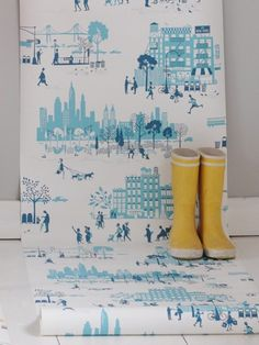 wallpaper - for walls or crafts.  Brownstone buildings, wrought iron fire escapes, rooftopwater towers, bustling streets and a truly unforgettable skyline. This is Morning in Manhattan, a new new collection (paper-cut style) from Famille Summerbelle. From eco-friendly wallpapers to tea towels and trays –a fun new collection out of the UK.