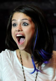 Selena debuted blue and purple streaks in her hair. Selena Selena, Selena Gomez 2012, Purple Hair Streaks, Light Blonde Hair, Bright Blue Hair, Bright Hair Colors, Bold Colors, Short Bob Hairstyles, Cool Hairstyles