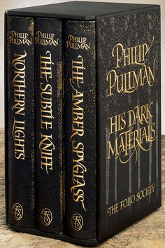 His Dark Materials trilogy by Phillip Pullman Includes: The Golden Compass, The Subtle Knife, and The Amber Spyglass Ruth Wilson, James Mcavoy, Book Cover Design, Book Design, His Dark Materials Trilogy, His Dark Materials Daemon, Books To Read, My Books, The Golden Compass