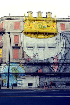 The Crono Project is creating street art on a massive scale. This corner building shows work by Os Gêmeos and Blu | Lisbo