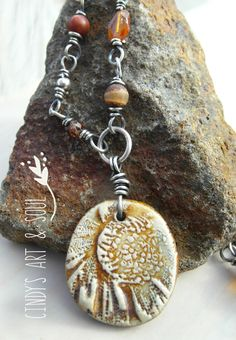 Sunflower Necklace Earth-tone Ceramic + Gemstone Beaded Chain by ArtandSoulJewelry on Etsy https://www.etsy.com/listing/217874202/sunflower-necklace-earth-tone-ceramic