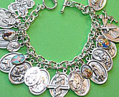 $85 silvertone bracelet filled with saint medals and religious charms featuring:  Four Way Cross  St. Dymphna  St. Raymond  St. Paul  St. Joseph  Padre Pio  Our Lady of Guadalupe  Divine Mercy  Our Lady of Fatima  Our Lady of Perpetual Help  Holy Family  Infant Jesus of Prague  St. Rita  Pope Benedict  Sacred Heart of Jesus  St. Francis of Assisi  St. Agnes    Charms: 2 Crosses, 2 Angels    Picture Charms: St. Francis of Assisi  Blessed Virgin Mary of Carmel  Our Lady of Perpetual Help