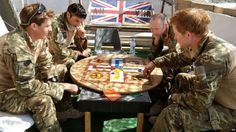 Prince Harry playing a game of Uckers in the very high readiness tent