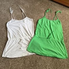 Swim coverups TWO swim coverups that have adjustable shoulder ties and tie around waist is adjustable.  Really good condition. Xhilaration Swim Coverups