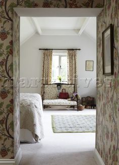 View through hallway to bedroom in Oxfordshire home  England  UK