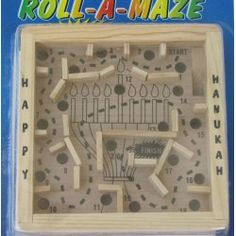 An innovative wooden maze game will keep your little one's hands busy at hanukkah and after. The classic wood styling makes it a visual delight. Some of the simplest toys provide the most fun and entertaining moments for the entire family. The game measures 5 x 5x 1.25. Recommended for children over 3 years old. Priced at $6.95