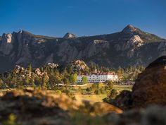Grand, historic, haunted—this Estes Park hotel so charms its guests that some have never left.  The Digs Looming in the shadow of Longs Peak, The Stanley Hotel of Estes Park, Colorado, has a rep...
