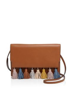 Totally obsessed with tassels? Rebecca Minkoff gets it. This vibrantly-hued…
