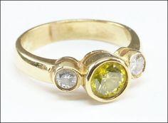 A DIAMOND AND 14 KARAT YELLOW GOLD RING. Lot 150-7168 #jewelry