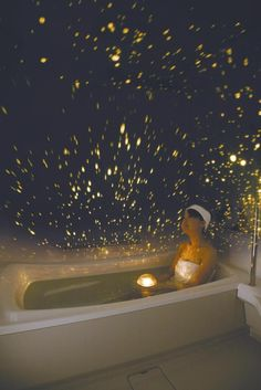 Y E S ! The waterproof planetarium floats in water  contains a bright light that projects out into the room, or even into the tub itself when flipped over.