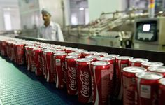 Coca Cola cans on a production line at a bottling plant near New Delhi in 2013. The company decided in April 2015 not to build an $81 million bottling plant in southern India because local farmers said it might exhaust groundwater supplies.