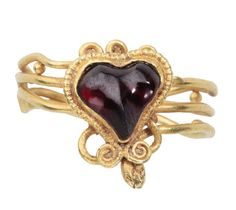 Greek snake ring with a garnet heart, Hellenistic Greece, 2nd-1st century BC. Les Enluminures