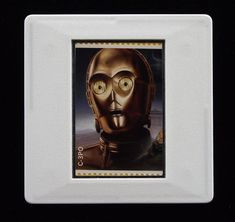 In 2018 the Royal Mail released a set of special stamps featuring some of the favourite droids, aliens and creatures of the Star Wars films. This 1st class stamp design shows C-3PO, a humanoid robot character who appears in the original trilogy, the prequel trilogy and the sequel trilogy. The unused stamp is encased in a vintage slide mount, with glass, making this a unique piece of jewellery. Robots Characters, Star Wars Characters, True Colors, Colours, Humanoid Robot, Presentation Cards, Star Wars Film, Original Trilogy, Royal Mail