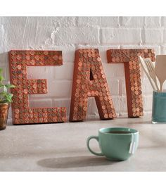 Don't know what to do with all the pennies you find lying around? Create awesome wall art!