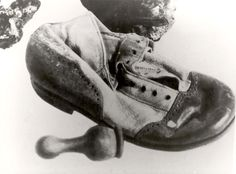 Treblinka, Poland, A child's shoe and a chess piece found among the items of the victims.