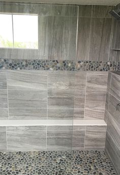 Gray stone look large format wall tile with pebble mosaic accent and shower floor  |  Master Shower Inspiration  |  Bathroom Ideas