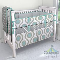 Crib bedding in White and Gray Polka Dot, Gray and White Polka Dot, Solid Teal, Silver Gray Minky, Aqua and Taupe Susette. Created using the Nursery Designer® by Carousel Designs where you mix and match from hundreds of fabrics to create your own unique baby bedding. #carouseldesigns