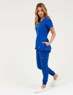 378510d2a00 The Tulip Top in Estate Navy Blue is a contemporary addition to women s  medical scrub outfits. Shop Jaanuu for scrubs
