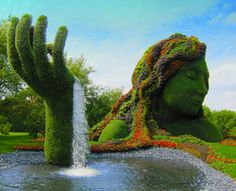 8. We love this stunning fountain made out of grass and flowers.