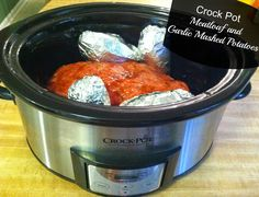 Slow Cooker Meatloaf and Garlic Mashed Potatoes - They're cooked in the same Crock Pot! Perfect for a busy weeknight dinner.