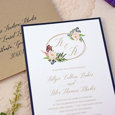 This is a pretty and elegant Floral Wreath Watercolor Wedding Invitation Set. It's a lovely mix of navy, gold and blush colors and just enough watercolor florals without being too much.
