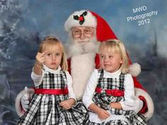 "A little girl flips the bird to show off an ""ouchy"" while sitting on Santa´s lap. Image via MWD Photography."